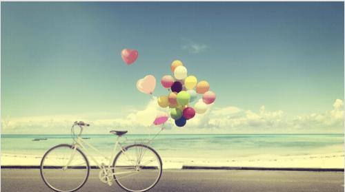 bicicleta-con-globos-playa